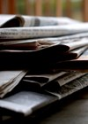 Photo showing pile of newspapers.